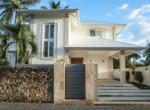 Modern tropical house steps from the beach 38