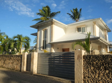 Modern tropical house steps from the beach 39